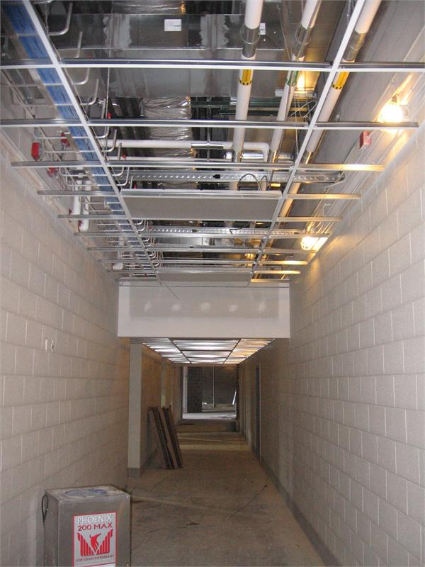 Hallway ceilings being installed